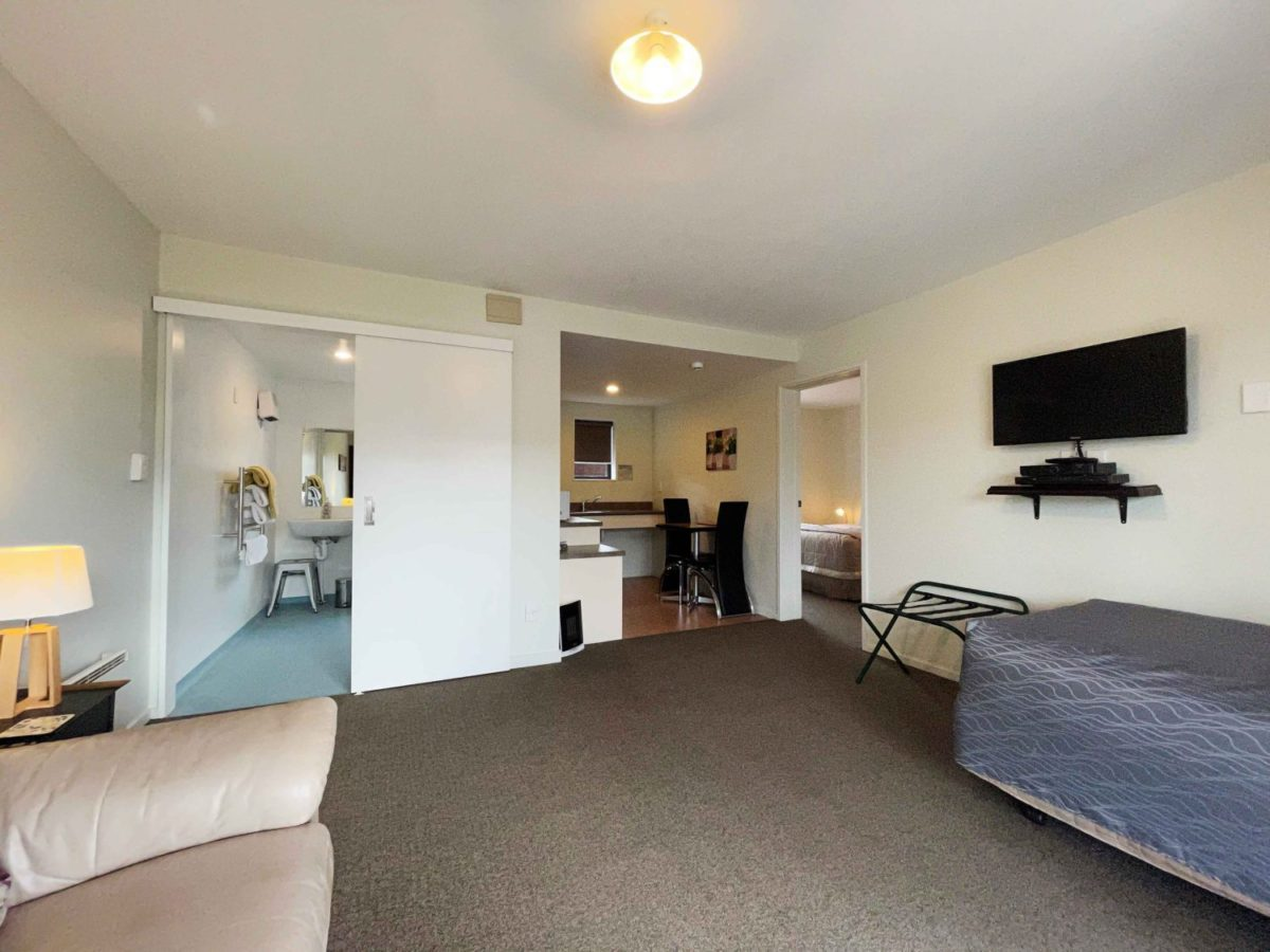 Access Studio Wheel chair access studio. Queen bed in one room and Single bed in the lounge area. Kitchenette, large bathroom, SKY TV & DVD player.