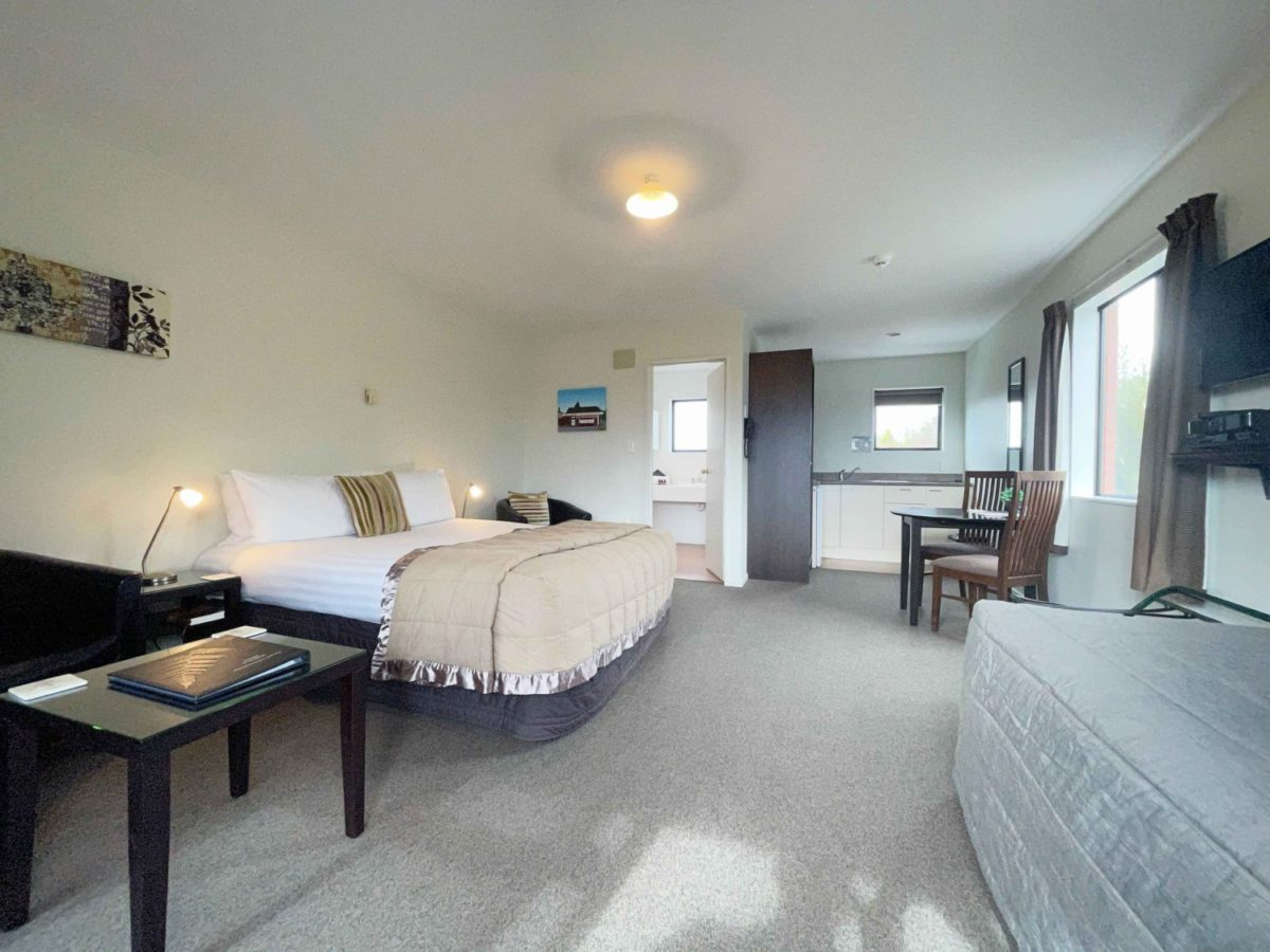 Studio Large studio unit with 1 Queen & 1 Single bed. Separate Ensuite. Kitchenette with microwave oven, electric frying pan, toaster & tea & coffee making facilities. SKY TV & DVD player.